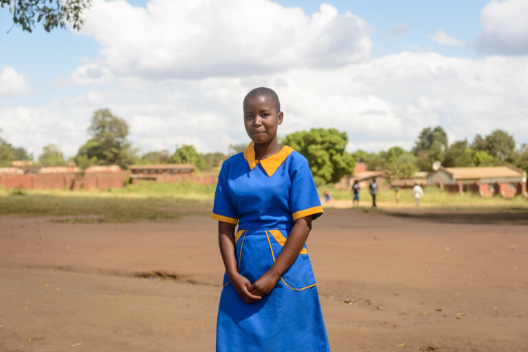 Young girl in Malawi wearing a blue dress